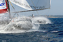 Louis Vuitton Trophy La Maddalena 28 maggio 2010. Le prue di Synergy Russian Sailing Team e di BMW Oracle volano sotto spi tra gli spruzzi durante una delle regate più spettacolari dell'evento velico.