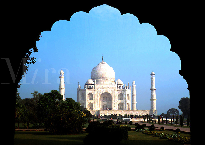 The Taj Mahal; framed by an ornamental, traditional Indian style arch. Agra, India.