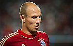 GUANGZHOU, GUANGDONG - JULY 26:  Arjen Robben of Bayern Munich looks on during a friendly match against VfL Wolfsburg as part of the Audi Football Summit 2012 on July 26, 2012 at the Guangdong Olympic Sports Center in Guangzhou, China. Photo by Victor Fraile / The Power of Sport Images