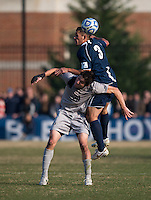 Andy Riemer (20) of Georgetown collides with Matthew Chavez (3) of San Diego during the game at North Kehoe Field in Washington, DC.  Georgetown defeated San Diego, 3-1.