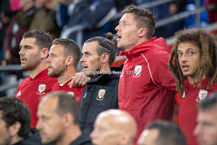 Cardiff - UK - 9th September :<br />Wales v Belarus Friendly match at Cardiff City Stadium.<br />Gareth Bale of Wales singing the national anthem on the substitute bench ahead of kick off.<br />Editorial use only