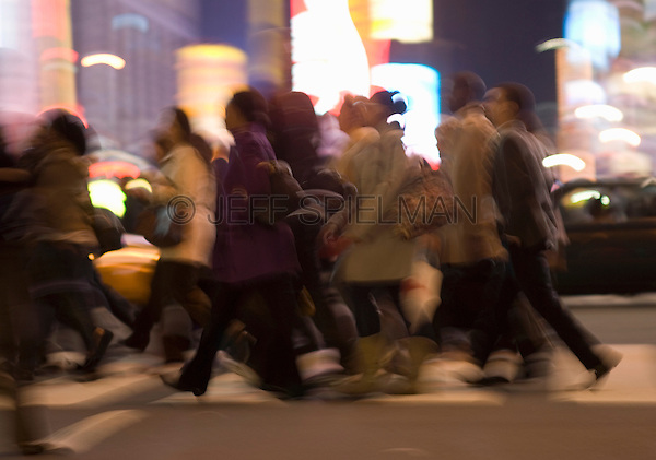 AVAILABLE FROM GETTY IMAGES FOR COMMERCIAL AND EDITORIAL LICENSING.   Please go to www.gettyimages.com and search for image # 135307810.<br /> <br /> Busy, Blurred Motion Scene of Commuters Crossing Street and Heading Home After Work During the Evening Rush Hour, Times Square and 42nd Street, Midtown Manhattan, New York City, New York State, USA