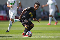 LOS ANGELES, CA - APRIL 17: Latif Blessing #7 of LAFC turns with the ball during a game between Austin FC and Los Angeles FC at Banc of California Stadium on April 17, 2021 in Los Angeles, California.