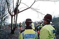 Police officers and security guards at a tree top environmental protesters demonstration. Demonstrators have climbed up into the trees to protest against the building of a by-pass and intend to stay until the authorities evict them. This image may only be used to portray the subject in a positive manner..©shoutpictures.com..john@shoutpictures.com