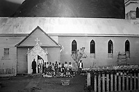Black & white photo of the church on Molokai where Father Danien provided spiritual and medical assistance to Hawaiian natives suffering from leprosy.  Photo is on display at the Father Damien museum which is located behind St. Augustine By The Sea