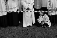 A young Czech altar boy waits before the open-air mass, served by the Pope Benedict XVI, starts in Stara Boleslav, one of the main pilgrimage site of the Czech Republic, September 28, 2009.