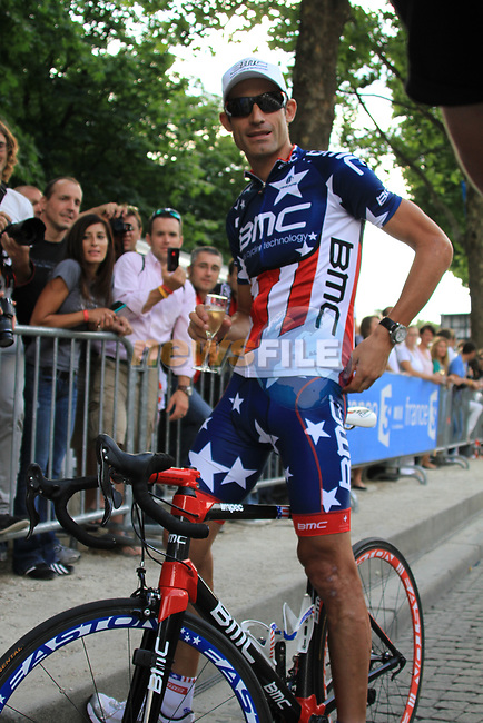 US Champion George Hincapie (USA) BMC Racing Team enjoys a glass of champagne part of the team parade at the end of the final Stage 20 of the 2010 Tour de France running 102.5km from Longjumeau to Paris Champs-Elysees, France. 25th July 2010.<br /> (Photo by Eoin Clarke/NEWSFILE).<br /> All photos usage must carry mandatory copyright credit (© NEWSFILE | Eoin Clarke)