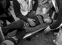 Palestinians carry their wounded away during a confrontation with Israeli soldiers in Ramallah. Palestine.
