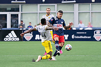 FOXBOROUGH, MA - MAY 16: Gustavo Bou #7 of New England Revolution passes the ball under pressure from Waylon Francis #14 Columbus SC during a game between Columbus SC and New England Revolution at Gillette Stadium on May 16, 2021 in Foxborough, Massachusetts.