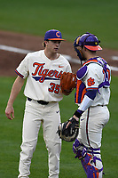 Relief pitcher Ryan Miller (35) of the Clemson Tigers talks with catcher Kyle Wilkie in a game against the Furman Paladins on Tuesday, February 20, 2018, at Doug Kingsmore Stadium in Clemson, South Carolina. Clemson won, 12-4. (Tom Priddy/Four Seam Images)