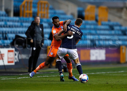 21st November 2020; The Den, Bermondsey, London, England; English Championship Football, Millwall Football Club versus Cardiff City; Leandro Bacuna of Cardiff City is challenged by Murray Wallace of Millwall