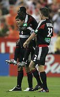 July 15, 2005: Washington, DC, USA:  DC United forward Jaime Moreno (99) celebrates his goal with teammates Bobby Boswell (32) and Freddy Adu (9) while playing the San Jose Earthquakes at RFK Stadium.  DC United won, 3-0.