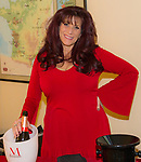 """Marla West opens bottles of sparkling wine before the Reno Magazine """"Bubbles Tasting"""" event at Total Wine in Reno on Friday night, February 9, 2018."""
