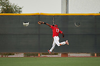 AZL Reds right fielder Fidel Castro (17) catches a fly ball during an Arizona League game against the AZL Athletics Green on July 21, 2019 at the Cincinnati Reds Spring Training Complex in Goodyear, Arizona. The AZL Reds defeated the AZL Athletics Green 8-6. (Zachary Lucy/Four Seam Images)
