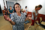 Katarina Atanazova prays during a worship service in the largely Roma neighborhood of Gorno Ezerovo, part of the Bulgarian city of Burgas. Residents here don't self-identify much as Roma, however, because of the negative connotations associated with the word, so many refer to themselves as a Turkish-speaking minority.