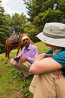 Local guide talking with western tourist, Gangabal Lake region of Kashmiri Himalayas, India.