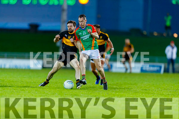 Brendan Falvey, Dr. Crokes in action against Cathal Moriarty, Mid Kerry during the Kerry County Senior Football Championship Semi-Final match between Mid Kerry and Dr Crokes at Austin Stack Park in Tralee, Kerry.
