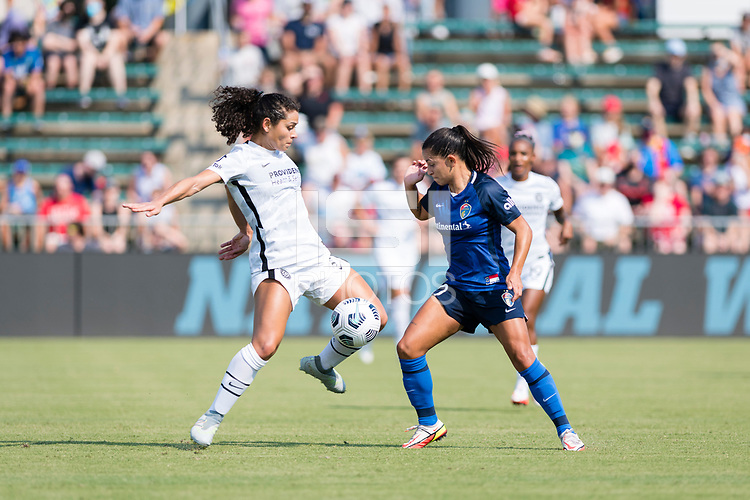 CARY, NC - SEPTEMBER 12: Rocky Rodriguez #11 of the Portland Thorns and Debinha #10 of the NC Courage battle for ball during a game between Portland Thorns FC and North Carolina Courage at WakeMed Soccer Park on September 12, 2021 in Cary, North Carolina.