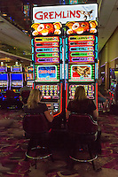 Las Vegas, Nevada.  Women Playing Slot Machines, Flamingo Casino.