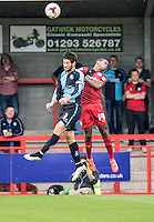 Joe Jacobson of Wycombe Wanderers wins the header with Lewis Young of Crawley Town during the Sky Bet League 2 match between Crawley Town and Wycombe Wanderers at Checkatrade.com Stadium, Crawley, England on 29 August 2015. Photo by Liam McAvoy.