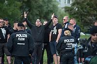 """Am Freitag den 10. Juli 2015 wurde die erste von zwei Containerunterkuenften fuer Fluechtlinge aus dem Buergerkrieg in Syrien im Berliner Bezirk Marzahn-Hellersdorf bei einem """"Tag der offenen Tuer"""" fuer die Anwohner geoffnet. Dies geschah, um die im Stadtteil weit verbreitete Angst und die Vorurteile abzubauen. Der Andrang der Anwohner war sehr gross.<br /> Gegen die Errichtung der zwei Containerunterkuenfte protestierten eine handvoll Nazis und Hooligans. (Im Bild) Zum Teil wurden rassistische Parolen gebruellt.<br /> Zum Schutz der Containerunterkuenfte vor rassistischen Protesten waren Mitarbeiter einer Securityfirma und zwei Hunderschaften der Polizei vor Ort. <br /> 10.7.2015, Berlin<br /> Copyright: Christian-Ditsch.de<br /> [Inhaltsveraendernde Manipulation des Fotos nur nach ausdruecklicher Genehmigung des Fotografen. Vereinbarungen ueber Abtretung von Persoenlichkeitsrechten/Model Release der abgebildeten Person/Personen liegen nicht vor. NO MODEL RELEASE! Nur fuer Redaktionelle Zwecke. Don't publish without copyright Christian-Ditsch.de, Veroeffentlichung nur mit Fotografennennung, sowie gegen Honorar, MwSt. und Beleg. Konto: I N G - D i B a, IBAN DE58500105175400192269, BIC INGDDEFFXXX, Kontakt: post@christian-ditsch.de<br /> Bei der Bearbeitung der Dateiinformationen darf die Urheberkennzeichnung in den EXIF- und  IPTC-Daten nicht entfernt werden, diese sind in digitalen Medien nach §95c UrhG rechtlich geschuetzt. Der Urhebervermerk wird gemaess §13 UrhG verlangt.]"""