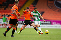 22nd August 2020; Tannadice Park, Dundee, Scotland; Scottish Premiership Football, Dundee United versus Celtic; Calum Butcher of Dundee United steps in to challenge for the ball with Mohamed Elyounoussi of Celtic