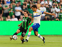 AUSTIN, TX - JUNE 19: Jared Stroud #20 of Austin FC and Oswaldo Alanis #4 of the SJ Earthquakes battle for control of the ball during a game between San Jose Earthquakes and Austin FC at Q2 Stadium on June 19, 2021 in Austin, Texas.