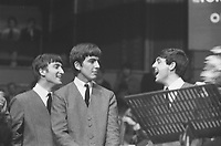 BNPS.co.uk (01202) 558833. <br /> Pic: OmegaAuctions/BNPS<br /> <br /> Pictured: A young Paul laughs on stage.  <br /> <br /> Previously unseen photos of the Beatles performing at the Royal Albert Hall have come to light 58 years on.<br /> <br /> The Fab Four took to the stage alongside a variety of acts including the Springfields and Del Shannon at the 'Swinging Sound' concert in April 1963.<br /> <br /> They were enjoying their newfound fame following the release of their first album 'Please Please Me' which stormed to the top of the UK charts.