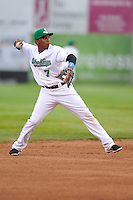 Shortstop Martin Peguero #7 of the Clinton LumberKings throws to first base against the West Michigan Whitecaps at Ashford University Field on July  25, 2014 in Clinton, Iowa. The Whitecaps won 9-0.   (Dennis Hubbard/Four Seam Images)