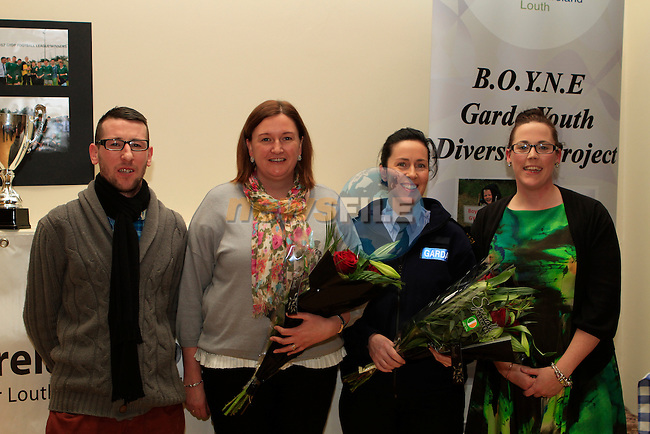 Sinead McCourt and Stephen Harrison make a presentation to Garda Anita O'Shea and Garda Catherine Rennick for their help at the Boyne Garda Youth Project Awards in the Holy Family Community Centre...Photo NEWSFILE/Jenny Matthews..(Photo credit should read Jenny Matthews/NEWSFILE)