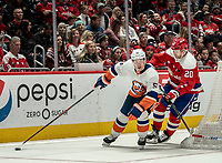 WASHINGTON, DC - JANUARY 31: Lars Eller #20 of the Washington Capitals trails Casey Cizikas #53 of the New York Islanders behind the Caps goal during a game between New York Islanders and Washington Capitals at Capital One Arena on January 31, 2020 in Washington, DC.