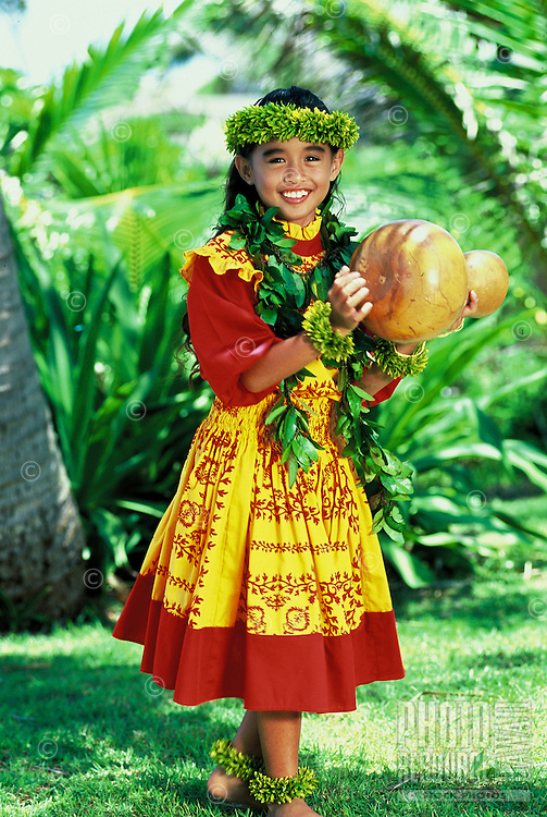 Lovely hula dancer (age 7) with ipu (gourd) and maile leis