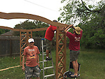volunteers building the sun shade