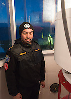 Chilean naval lighthouse keeper Melgirejo in the lantern gallery at Cabo Espiritu Santo lighthouse -Tierra del Fuego, Chile