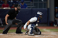 Hudson Valley Renegades catcher Anthony Seigler (20) blocks a pitch in the dirt as home plate umpire Tyler White looks on during the game against the Wilmington Blue Rocks at Dutchess Stadium on July 27, 2021 in Wappingers Falls, New York. (Brian Westerholt/Four Seam Images)