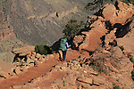 Woman backpacker hiking down the South Kaibab Trail to Cedar Ridge, Grand Canyon National Park, northern Arizona, USA .  John leads hiking and photo tours throughout Colorado. . John offers private photo tours in Grand Canyon National Park and throughout Arizona, Utah and Colorado. Year-round.