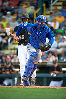 Toronto Blue Jays catcher A.J. Jimenez (8) checks the runner while retrieving the ball after blocking a pitch with Josh Bell (55) batting during a Spring Training game against the Pittsburgh Pirates on March 3, 2016 at McKechnie Field in Bradenton, Florida.  Toronto defeated Pittsburgh 10-8.  (Mike Janes/Four Seam Images)