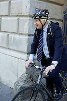 Boris Johnson leaving London Fashion Week on a bicycle