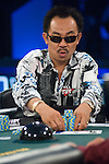 """David """"The Dragon"""" Pham pushes some chips out."""