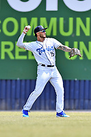 Asheville Tourists right fielder Niko Decolati (19) warms up between innings during a game against the West Virginia Power at McCormick Field on June 2, 2019 in Asheville, North Carolina. The  Power defeated the Tourists 5-4. (Tony Farlow/Four Seam Images)