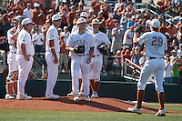 Texas Longhorns starting pitcher Dillon Peters #32 tosses the baseball to closer Corey Knebel #29 in the eighth inning of the NCAA baseball game against the Oklahoma Sooners on April 6, 2013 at UFCU DischFalk Field in Austin, Texas. The Longhorns defeated the rival Sooners 1-0. (Andrew Woolley/Four Seam Images).