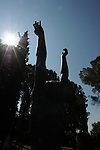 A sculpture created by Ivan Mestrovic reaches skyward in the outside gardens of his home.