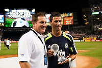 Cristiano Ronaldo (7) of Real Madrid is presented the MVP trophy by Chris Clews, partner in Incapital. Real Madrid defeated A. C. Milan 5-1 during a 2012 Herbalife World Football Challenge match at Yankee Stadium in New York, NY, on August 8, 2012.