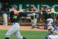 Adam Engel (26) of the Great Falls Voyagers swings at the pitch with Ogden Raptors catcher Austin Cowen (15) behind the plate in Pioneer League play at Lindquist Field on August 16, 2013 in Ogden Utah.  (Stephen Smith/Four Seam Images)
