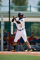GCL Pirates Tilsaimy Melfor (12) at bat during a Gulf Coast League game against the GCL Twins on August 6, 2019 at Pirate City in Bradenton, Florida.  GCL Twins defeated the GCL Pirates 1-0 in the second game of a doubleheader.  (Mike Janes/Four Seam Images)