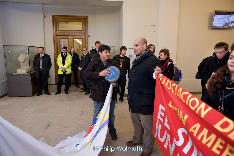 Security guards watch a demonstration inside University College London organised by UCL's Living Wage Campaign in support of Juan Carlos Piedra Benitez, who was sacked by cleaning contractor Office & General following his involvement in a trade union campaign for improved pay and conditions.