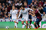Isco Alarcon (l) of Real Madrid fights for the ball with Paulo Andre Rodrigues de Oliveira (r) of SD Eibar during the La Liga 2017-18 match between Real Madrid and SD Eibar at Estadio Santiago Bernabeu on 22 October 2017 in Madrid, Spain. Photo by Diego Gonzalez / Power Sport Images