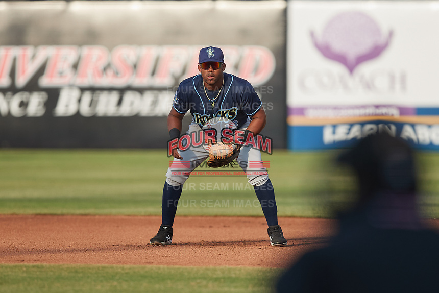 Wilmington Blue Rocks first baseman Omar Meregildo (13) on defense against the Greensboro Grasshoppers at First National Bank Field on May 25, 2021 in Greensboro, North Carolina. (Brian Westerholt/Four Seam Images)