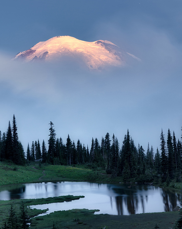 Early morning sunrise with fog. Tipsoo Lake reflection. Mt. Rainier National Par, Washington