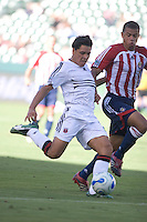 D.C. United's Christian Gomez shoots for his second goal of the game while being chased by Chivas USA's Jason Hernandez.  D.C. United defeated Chivas USA, 2-1, at the Home Depot Center in Carson, Calif. on September 3, 2006.